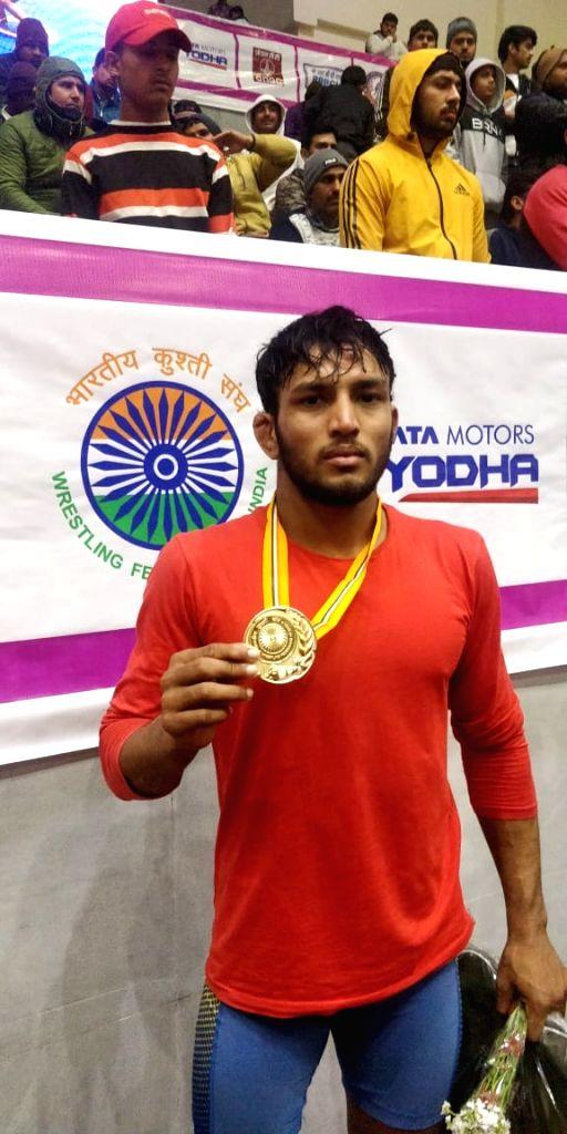 Rohit wins 65kg title at wrestling nationals .