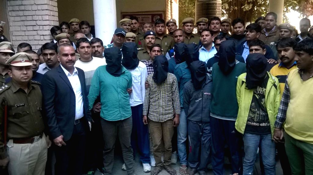 Haryana Police presents the eight people who have been arrested over the barbaric rape and murder of a 28-year-old mentally-challenged woman at district court in Rohtak on Feb 10, 2015.