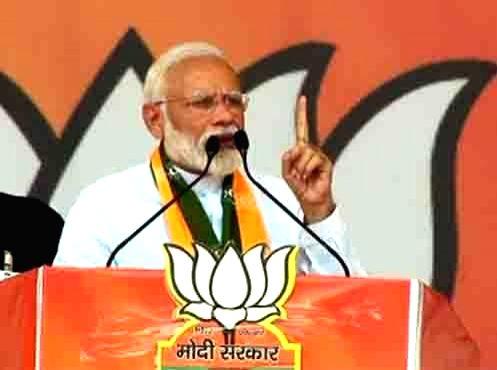 Rohtak: Prime Minister Narendra Modi addresses a public rally in Rohtak, Haryana on May 10, 2019. (Photo: IANS) - Narendra Modi