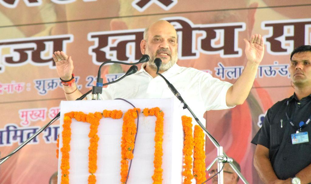 Rohtak: Union Home Minister Amit Shah addresses during International Yoga Day 2019 programme in Rohtak, Haryana on June 21, 2019. (Photo: IANS) - Amit Shah