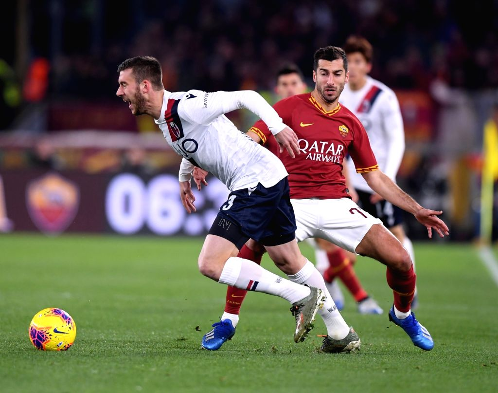 Roma's Hernich Mkhitaryan (R) vies with Bologna's Mattia Bani during a Serie A soccer match between Roma and Bologna in Rome, Italy, Feb. 7, 2020.
