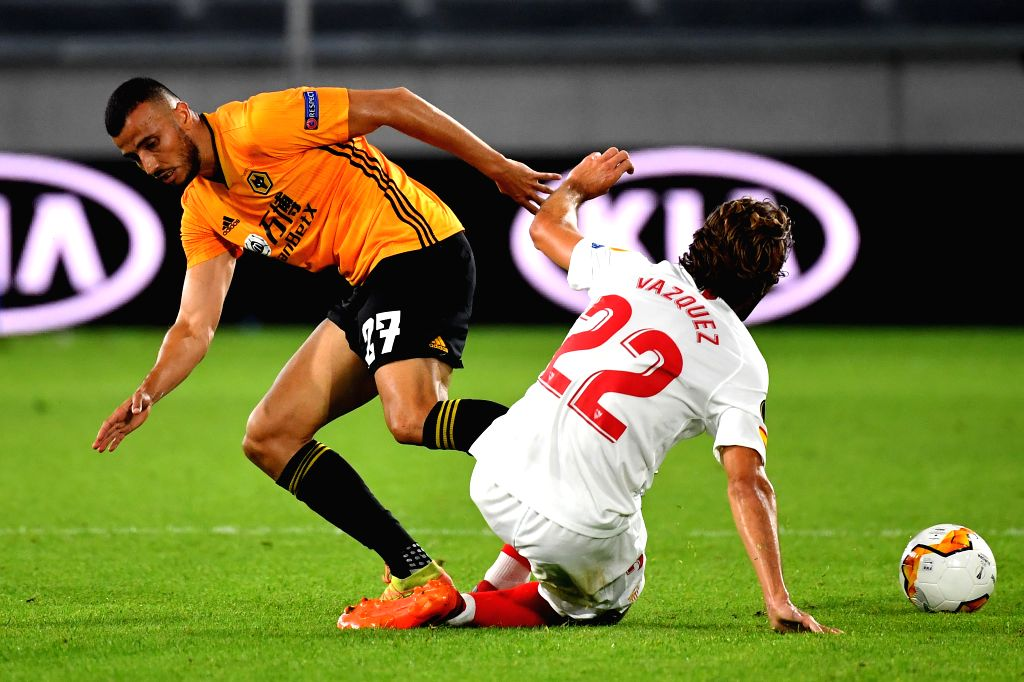 Romain Saiss (L) of Wolverhampton Wanderers vies with Franco Vazquez of Sevilla during the UEFA Europa League quarterfinal between Wolverhampton Wanderers and ...