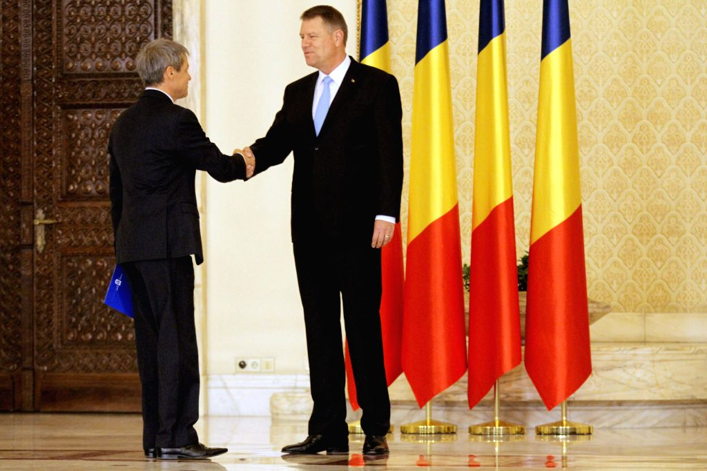 Romania's new Prime Minister Dacian Ciolos (L) shakes hands with Romanian President Klaus Iohannis after the swearing-in ceremony of the new government in ... - Dacian Ciolos