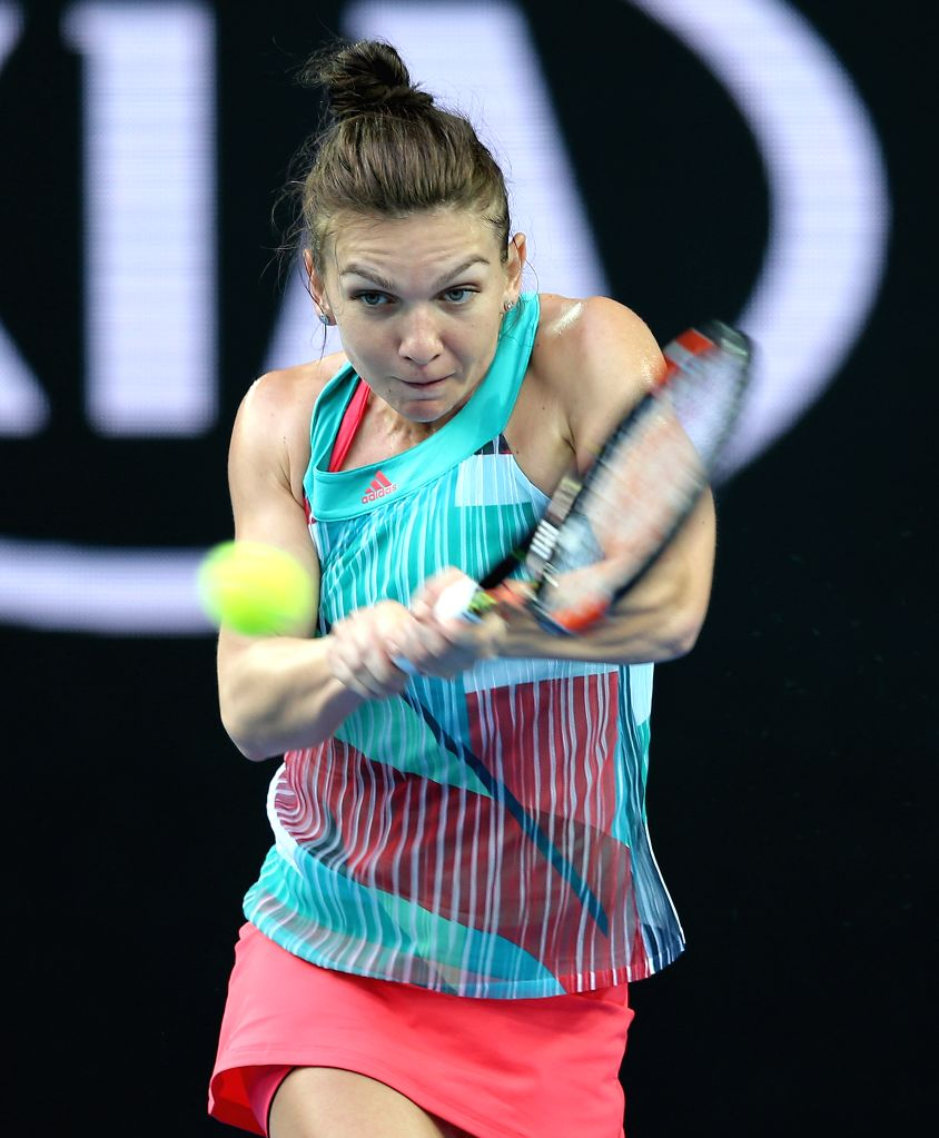 Romania's Simona Halep competes against China's Zhang Shuai during the first round match of women's singles at the Australian Open Tennis Championships in ...