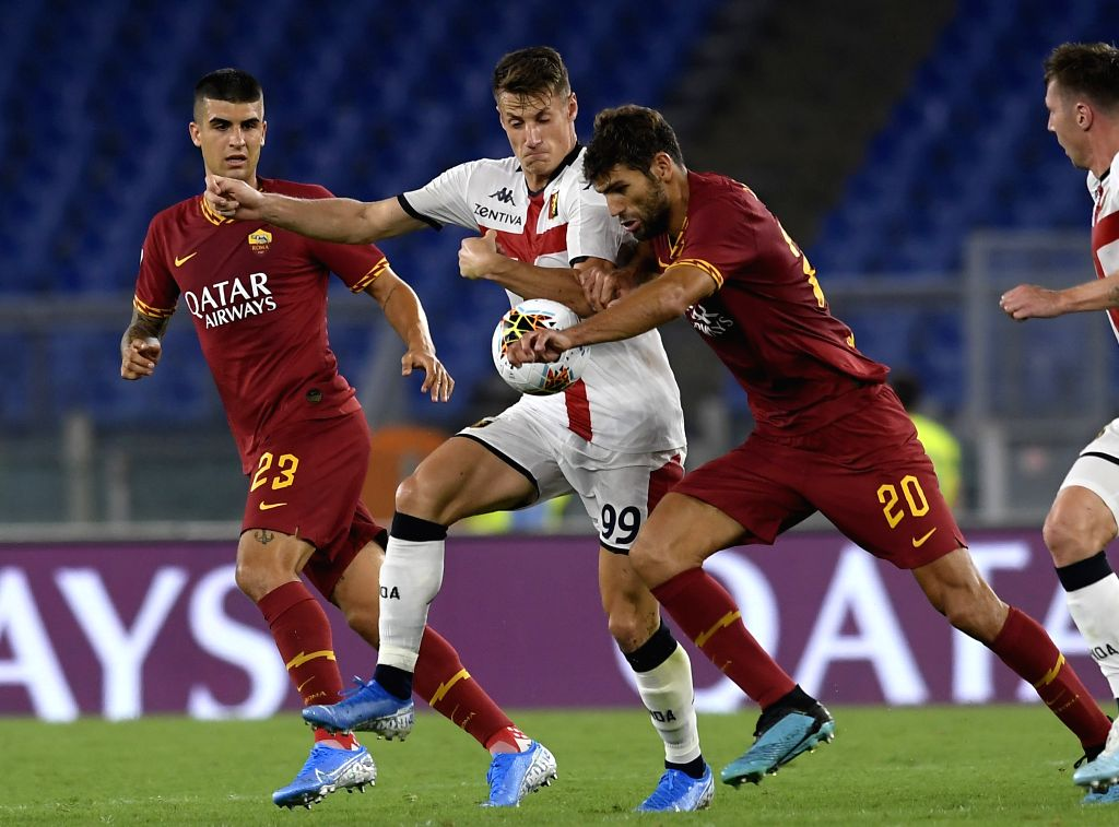 ROME, Aug. 26, 2019 - Genoa's Andrea Pinamonti (2nd L) vies with Roma's Federico Fazio (2nd R) during a Serie A soccer match between Roma and Genoa in Rome, Italy, Aug. 25, 2019.