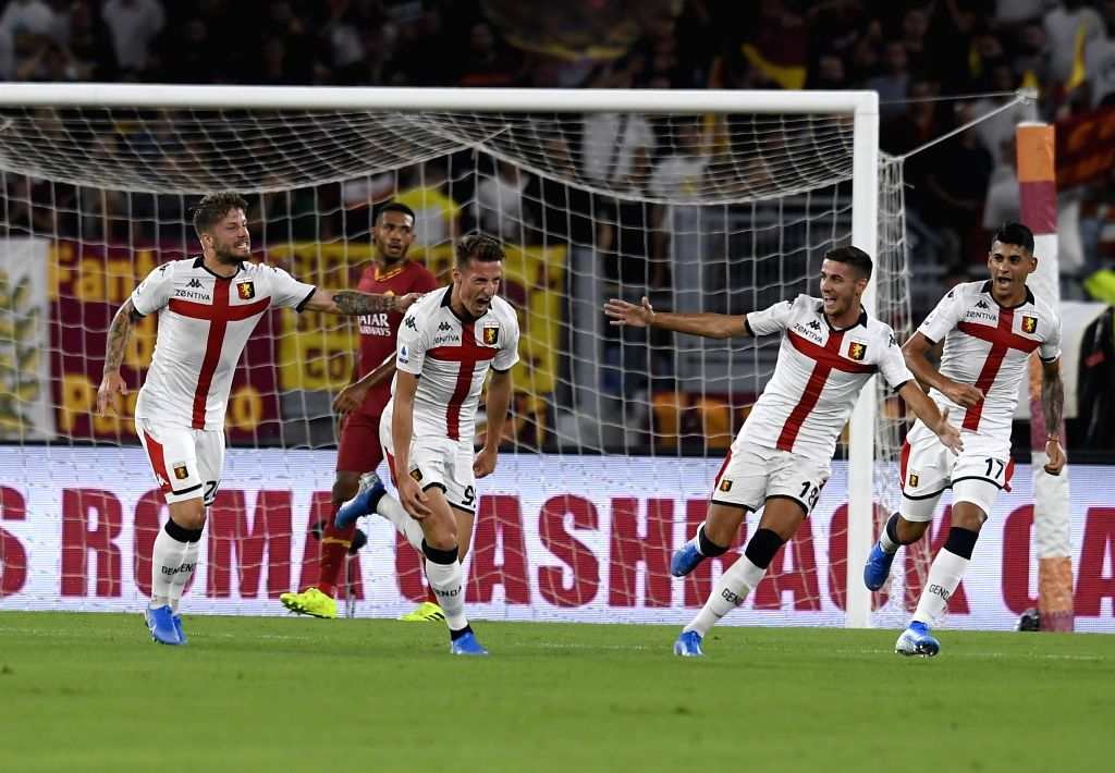 ROME, Aug. 26, 2019 - Genoa's Andrea Pinamonti (front, 2nd L) celebrates his goal during a Serie A soccer match between Roma and Genoa in Rome, Italy, Aug. 25, 2019.