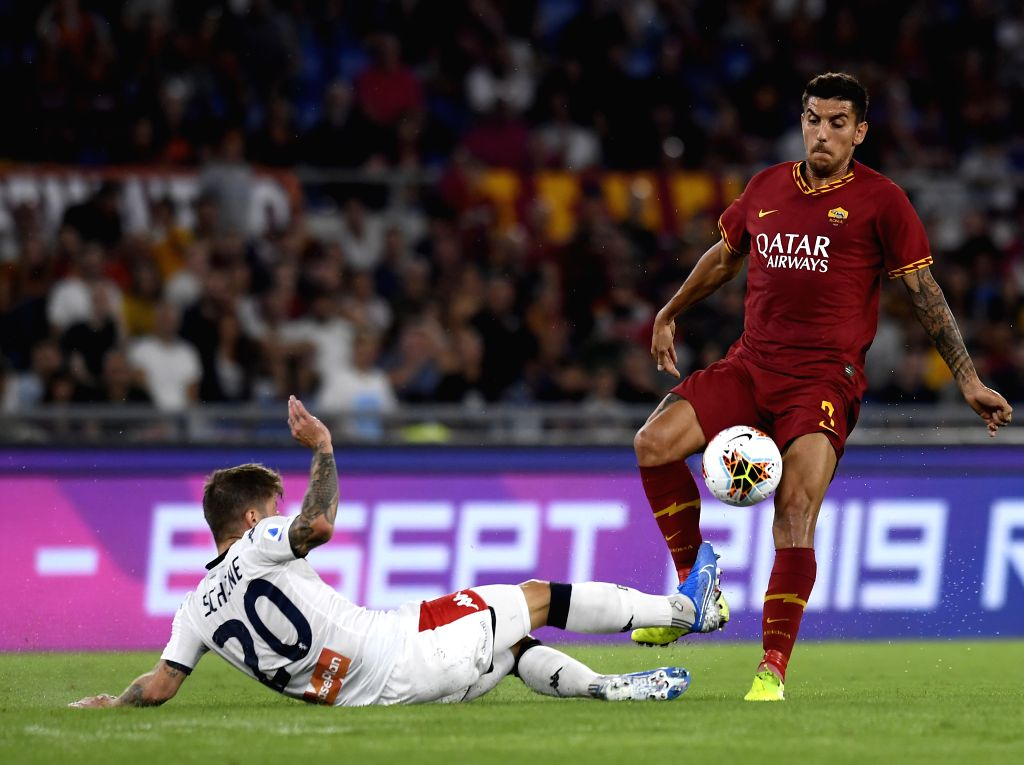 ROME, Aug. 26, 2019 - Genoa's Lasse Schone (L) vies with Roma's Lorenzo Pellegrini during a Serie A soccer match between Roma and Genoa in Rome, Italy, Aug. 25, 2019.