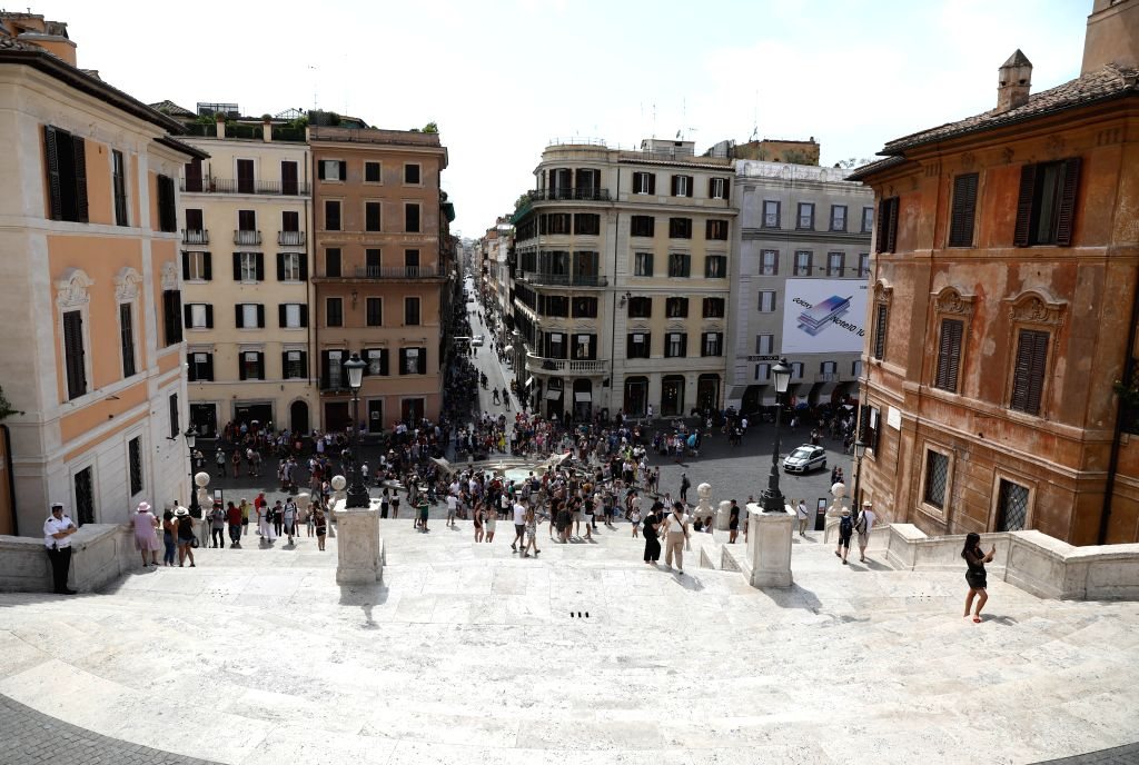 ROME, Aug. 8, 2019 - Tourists visit the Spanish Steps in Rome, Italy, on Aug. 8, 2019. Sitting on the Rome's Spanish Steps has been banned, according to Italian local media. Violators could be fined ...
