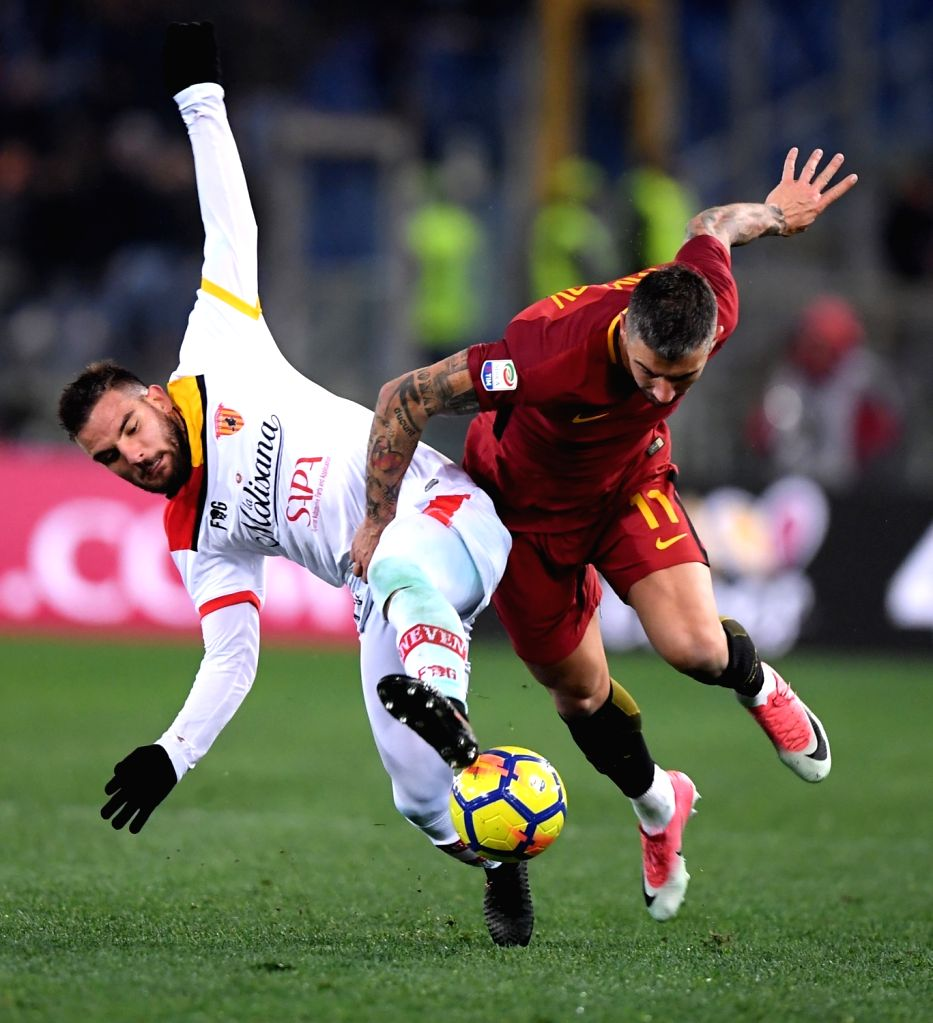 ROME, Feb. 12, 2018 - Benevento's Enrico Brignola(L) vies with Roma's Aleksandar Kolarov during a Serie A soccer match between Roma and Benevento in Rome, Italy, Feb. 11, 2018. Roma won 5-2.