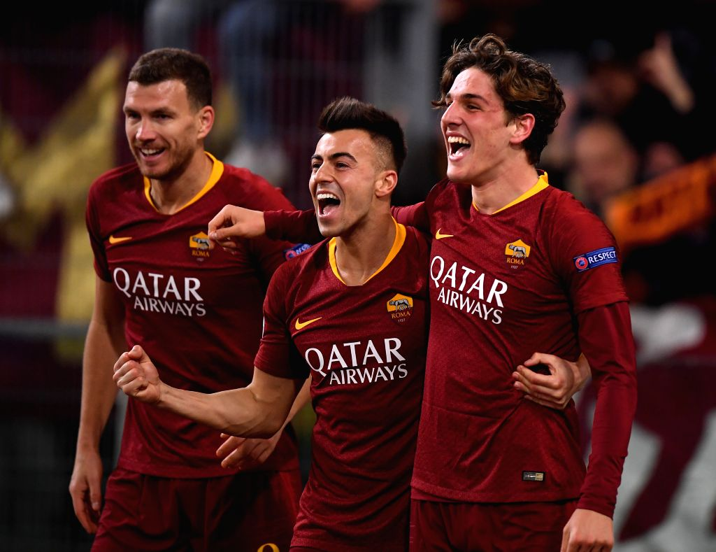 ROME, Feb. 13, 2019 - Roma's Niccolo Zaniolo (R) celebrates with his teammate Stephan El Shaarawy (C) after scoring during the UEFA Champions League round of 16 first leg soccer match between Roma ...