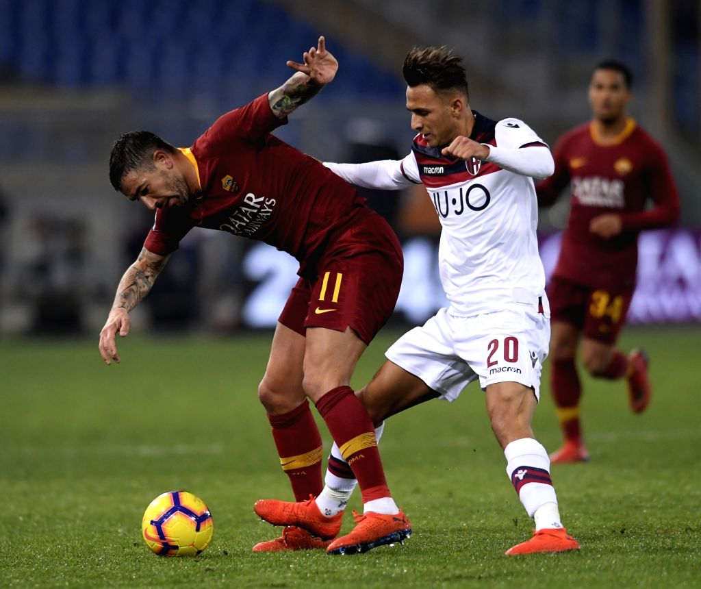 ROME, Feb. 19, 2019 - Roma's Aleksandar Kolarov (L) vies with Bologna's Simone Edera during a Serie A soccer match between AS Roma and Bologna in Rome, Italy, Feb. 18 , 2019. Rome won 2-1.