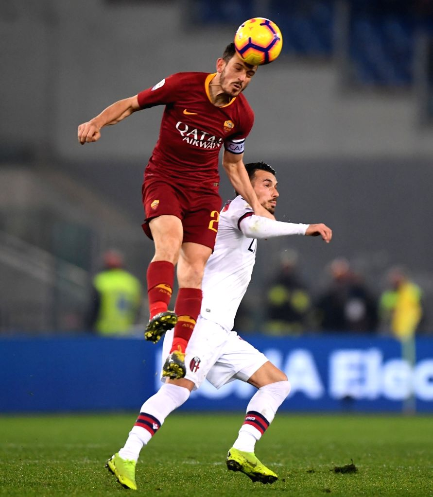 ROME, Feb. 19, 2019 - Roma's Alessandro Florenzi (L) vies with Bologna's Nicola Sansone during a Serie A soccer match between AS Roma and Bologna in Rome, Italy, Feb. 18 , 2019. Rome won 2-1.