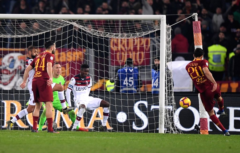 ROME, Feb. 19, 2019 - Roma's Federico Fazio (1st R) scores during a Serie A soccer match between AS Roma and Bologna in Rome, Italy, Feb. 18 , 2019. Rome won 2-1.