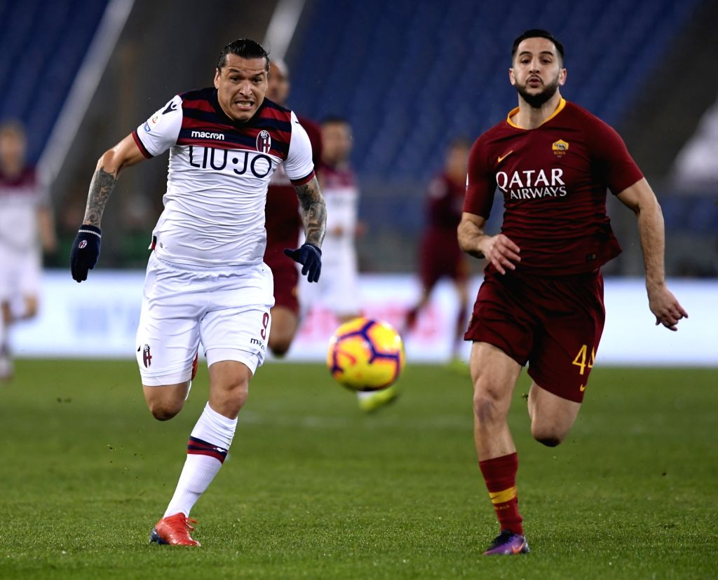 ROME, Feb. 19, 2019 - Roma's Kostas Manolas (R) vies with Bologna's Federico Santander during a Serie A soccer match between AS Roma and Bologna in Rome, Italy, Feb. 18 , 2019. Rome won 2-1.