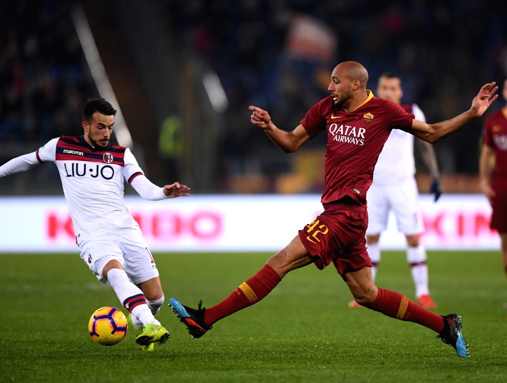 ROME, Feb. 19, 2019 - Roma's Steven Nzonzi (R) vies with Bologna's Nicola Sansone during a Serie A soccer match between AS Roma and Bologna in Rome, Italy, Feb. 18 , 2019. Rome won 2-1.