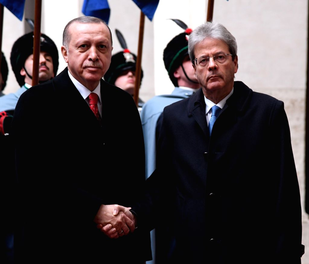 ROME, Feb. 5, 2018 - Italian Prime Minister Paolo Gentiloni (R) shakes hands with visiting Turkish President Recep Tayyip Erdogan during their meeting in Rome, Italy, on Feb. 5, 2018. Turkish ... - Paolo Gentiloni