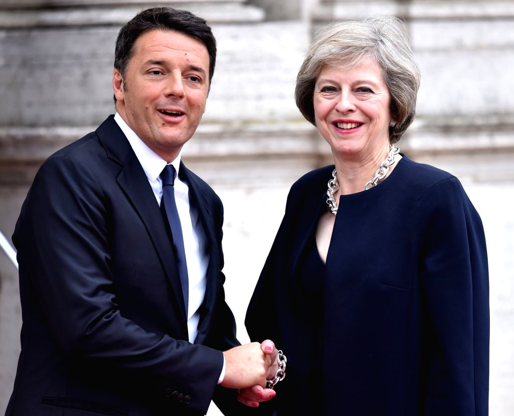 ROME, July 28, 2016 - Italian Prime Minister Matteo Renzi (L) shakes hand with his British counterpart Theresa May during a meeting in Rome, Italy, on July 27, 2016. Italian Prime Minister Matteo ... - Matteo Renzi