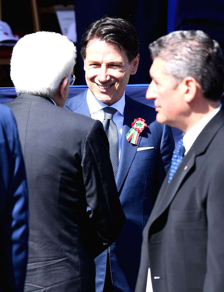 ROME, June 2, 2018 - Italian Prime Minister Giuseppe Conte (C) holds hands with Italian President Sergio Mattarella during the ceremony marking the Republic Day in Rome, Italy, on June 2, 2018. - Giuseppe Conte