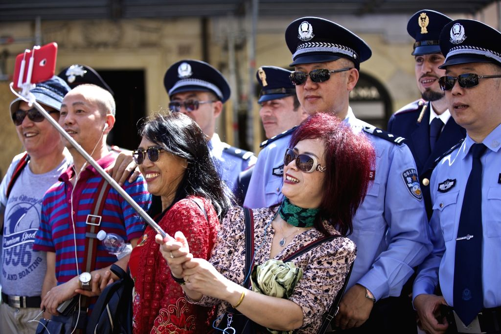 ROME, June 5, 2017 - Tourists take a photo with Chinese and Italian police officers at Piazza di Spagna of Rome, Italy, on June 5, 2017. A joint policing project between China and Italy was presented ...