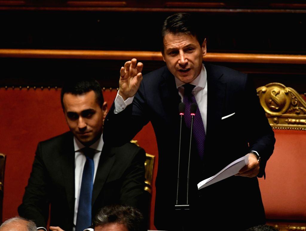 ROME, June 5, 2018 - Italian Prime Minister Giuseppe Conte (R) speaks ahead of the confidence vote in Senate in Rome, Italy, on June 5, 2018. The new Italian government led by Prime Minister Giuseppe ... - Giuseppe Conte