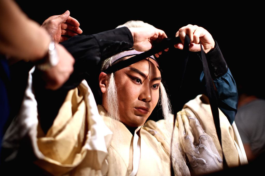 "ROME, March 13, 2017 - Liu Dake, who plays the role of Faust, puts on makeup backstage before the performance of experimental Peking opera ""Faust"" in Rome, Italy, March 12, 2017. ..."