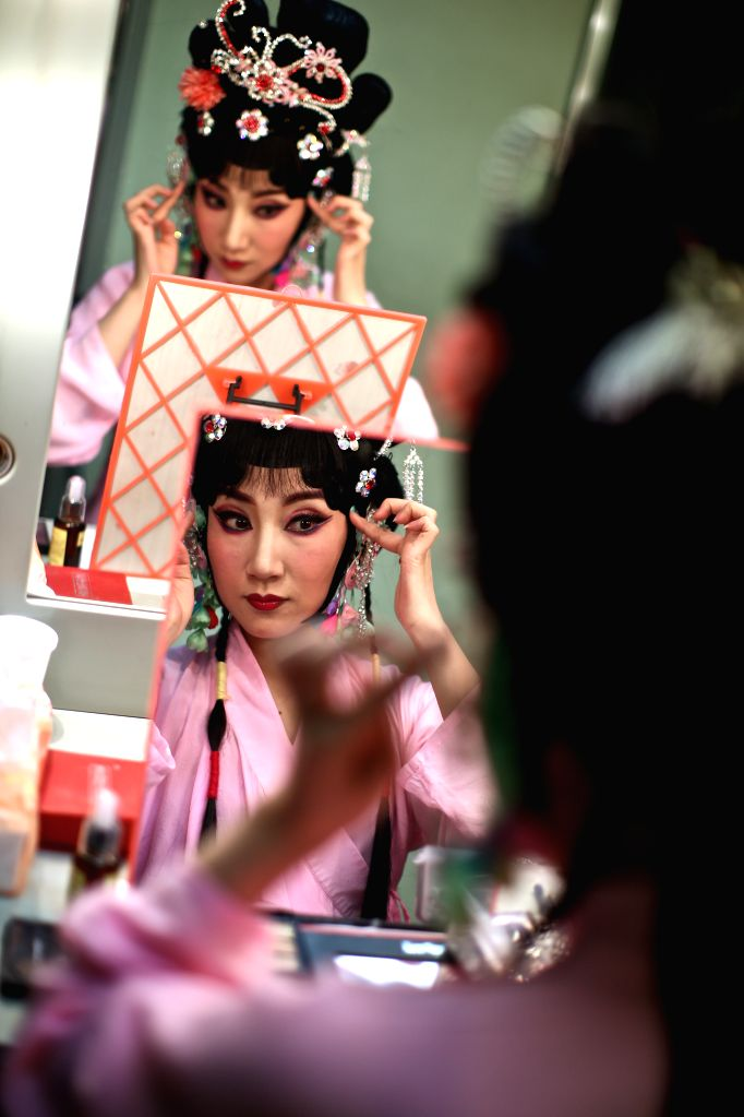 "ROME, March 13, 2017 - Zhang Jiachun, who plays the role of Gretchen, puts on makeup backstage before the performance of experimental Peking opera ""Faust"" in Rome, Italy, March 12, 2017. ..."