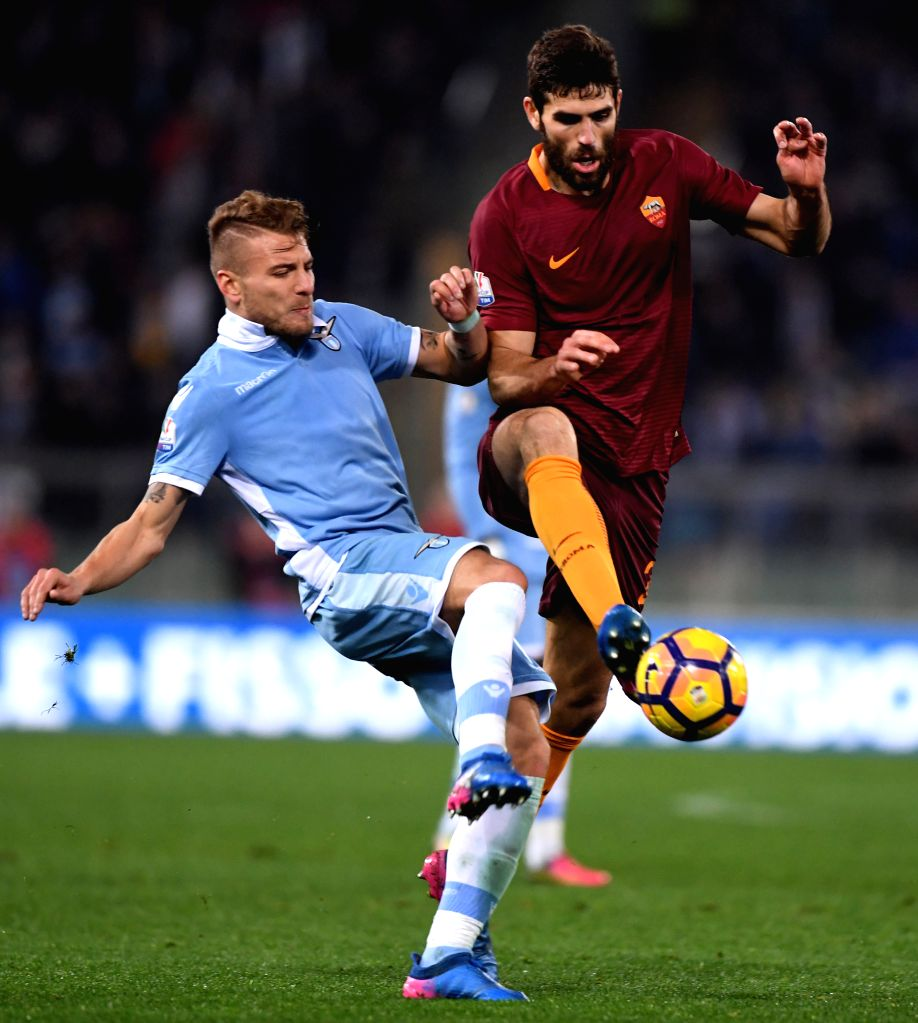 ROME, March 2, 2017 - Lazio's Felipe Anderson (L) competes with Roma's Antonio Rudiger during the Italian Cup first leg semifinal football match in Rome, Italy, March 1, 2017. Lazio won the match 2-0.