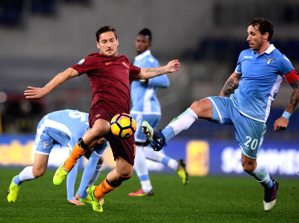 ROME, March 2, 2017 - Roma's Francesco Totti (L) competes with Lazio's Lucas Biglia during the Italian Cup first leg semifinal football match in Rome, Italy, March 1, 2017. Lazio won the match 2-0.