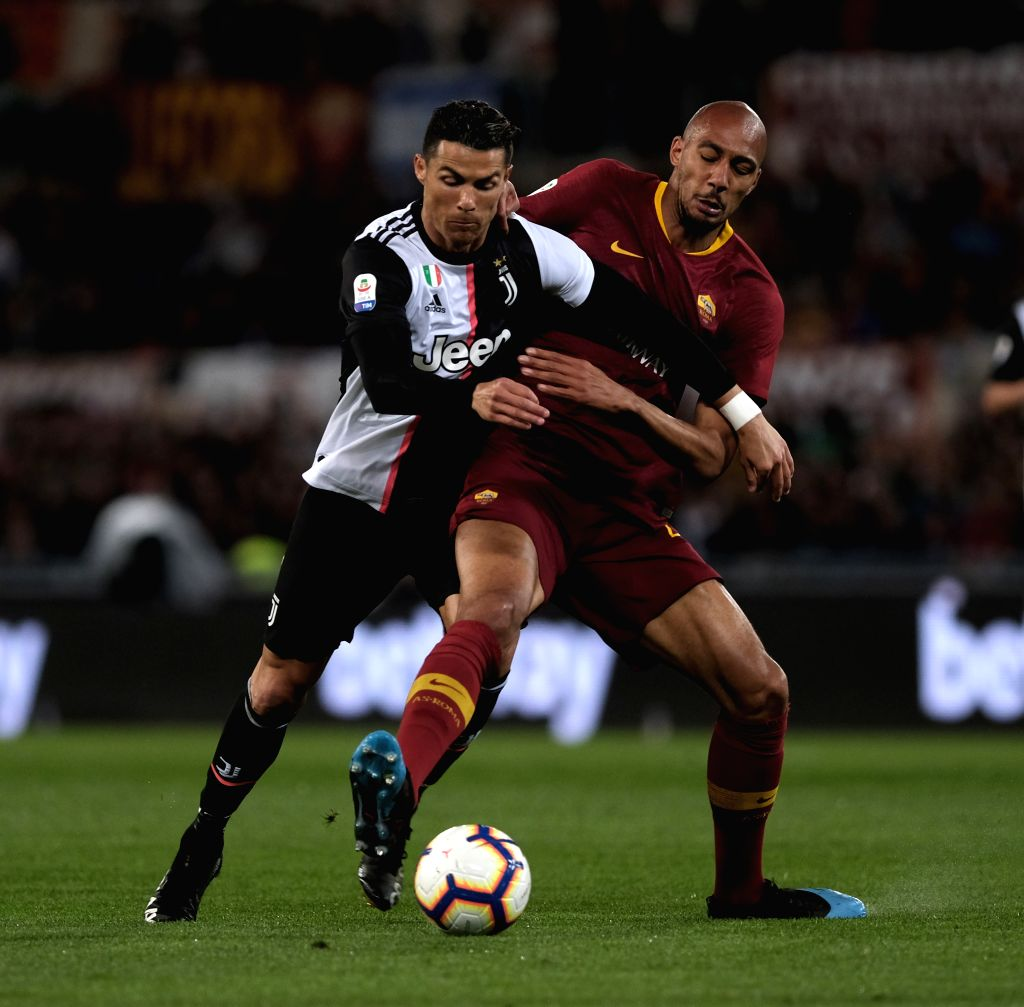 ROME, May 13, 2019 - FC Juventus's Cristiano Ronaldo (L) vies with Roma's Steven Nzonzi during a Serie A soccer match between Roma and FC Juventus in Rome, Italy, May 12 , 2019. Roma won 2-0.