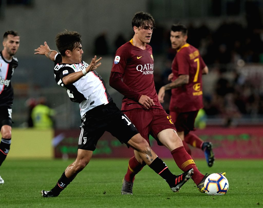 ROME, May 13, 2019 - FC Juventus's Paulo Dybala (L) vies with Roma's Nicolo Zaniolo during a Serie A soccer match between Roma and FC Juventus in Rome, Italy, May 12 , 2019. Roma won 2-0.
