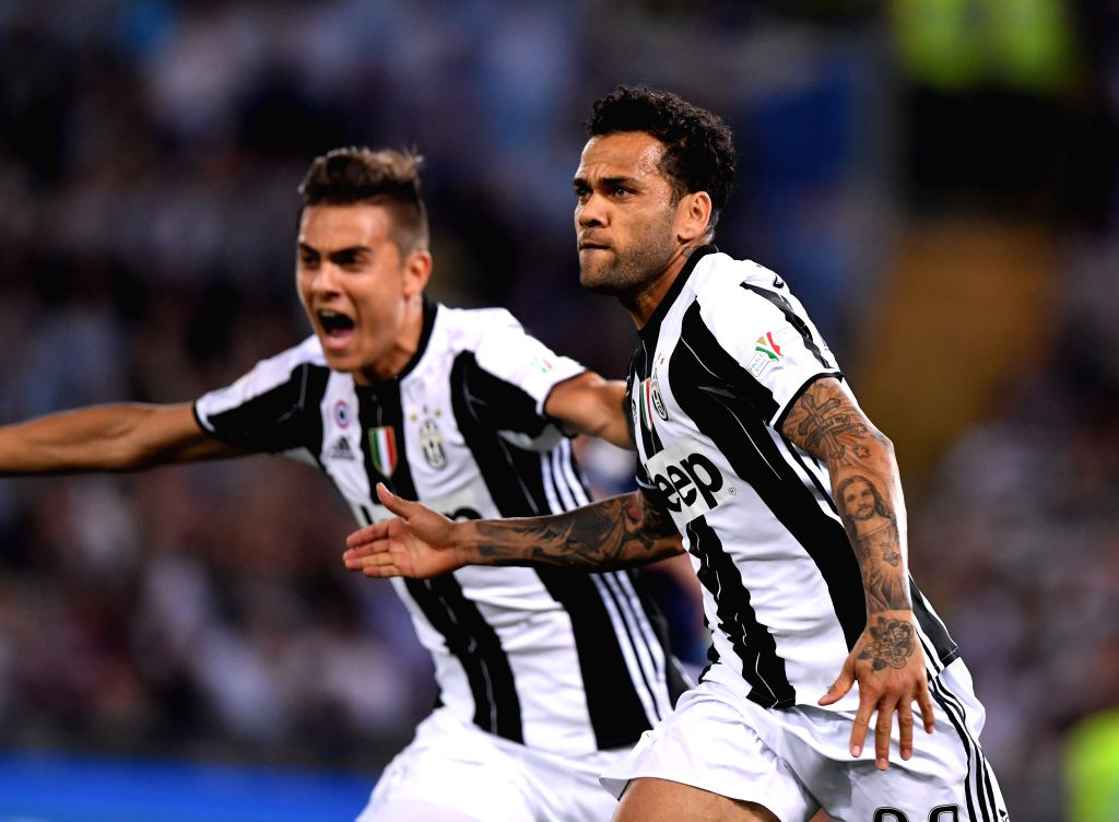 ROME, May 18, 2017 - Dani Alves (R) of Juventus celebrates scoring during the Italian Cup final between Juventus and Lazio in Rome, Italy, on May 17, 2017. Juventus claimed the title with 2-0.