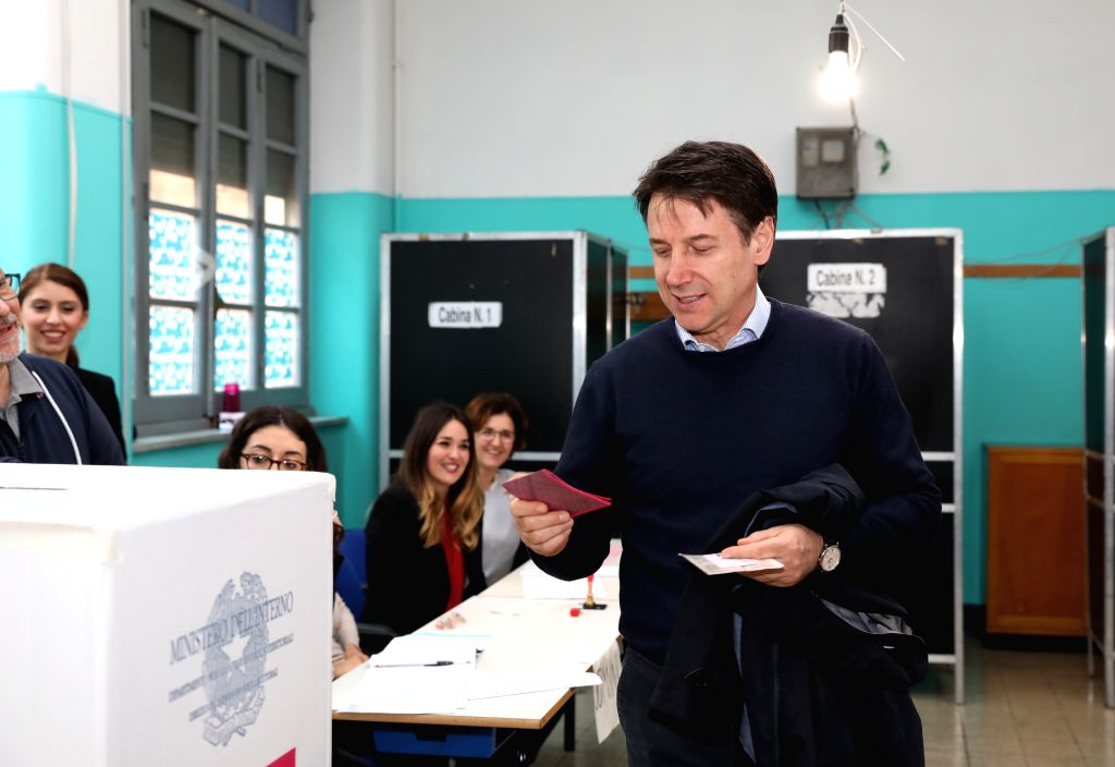 ROME, May 26, 2019 - Italian Prime Minister Giuseppe Conte (R) prepares to cast his ballot at a polling station in Rome, Italy, May 26, 2019. The European Parliament (EU) elections started in Italy ... - Giuseppe Conte