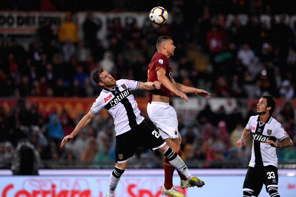 ROME, May 27, 2019 - AS Roma's Edin Dzeko (C) vies with Parma's Riccardo Gagliolo (L) during a Serie A soccer match between AS Roma and Parma in Rome, Italy, May 26, 2019. AS Roma won 2-1.