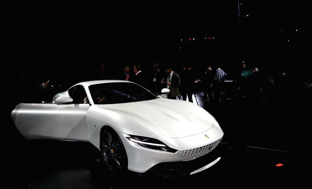 ROME, Nov. 14, 2019 - People look at a Ferrari's new model Roma in Rome, Italy, on Nov. 14, 2019. Italian luxury sports car manufacturer Ferrari launched its new model Roma, a coupe meant to revive ... - Roma