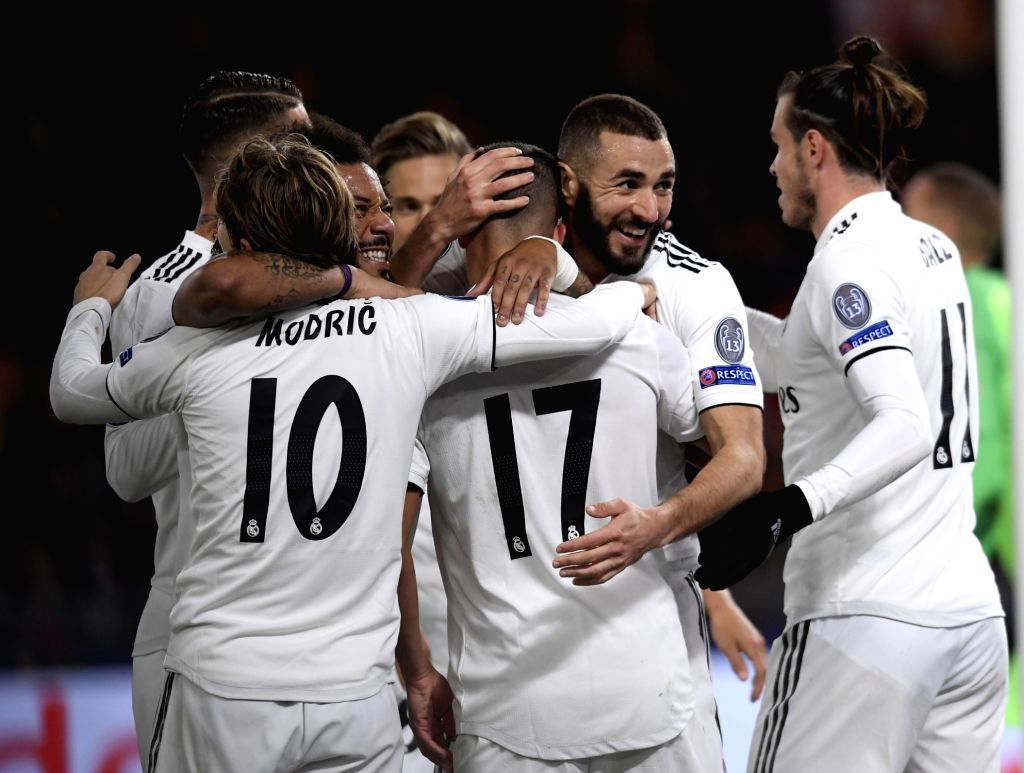 ROME, Nov. 28, 2018 - Real Madrid's Lucas Vazquez (C) celebrates by his teammates during a group G match of UEFA Champions League between Roma and Real Madrid, in Rome, Italy, Nov. 27, 2018. Real ...