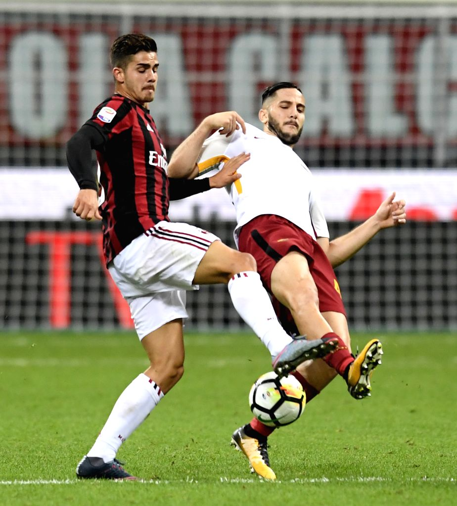 ROME, Oct. 2, 2017 - Kostas Manolas (R) of Roma vies with Andre Silva of AC Milan during a Serie A soccer match between AC Milan and Roma in Milan, Italy, Otc. 1, 2017. Roma won 2-0.