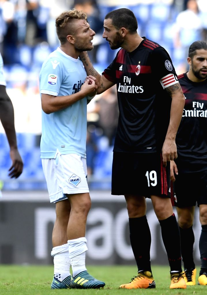 ROME, Sept. 11, 2017 - Lazio's Ciro Immobile (L) talks with AC Milan's Leonardo Bonucci at the end of the Italian Serie A soccer match between Lazio and AC Milan, in Rome, Italy, Sept. 10, 2017. ...