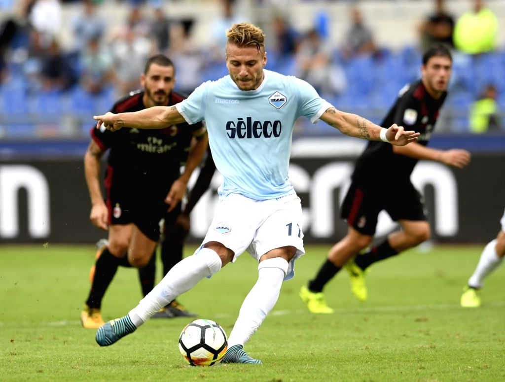 ROME, Sept. 11, 2017 - Lazio's Ciro Immobile shoots to score his first goal during the Italian Serie A soccer match between Lazio and AC Milan, in Rome, Italy, Sept. 10, 2017. Lazio won 4-1.