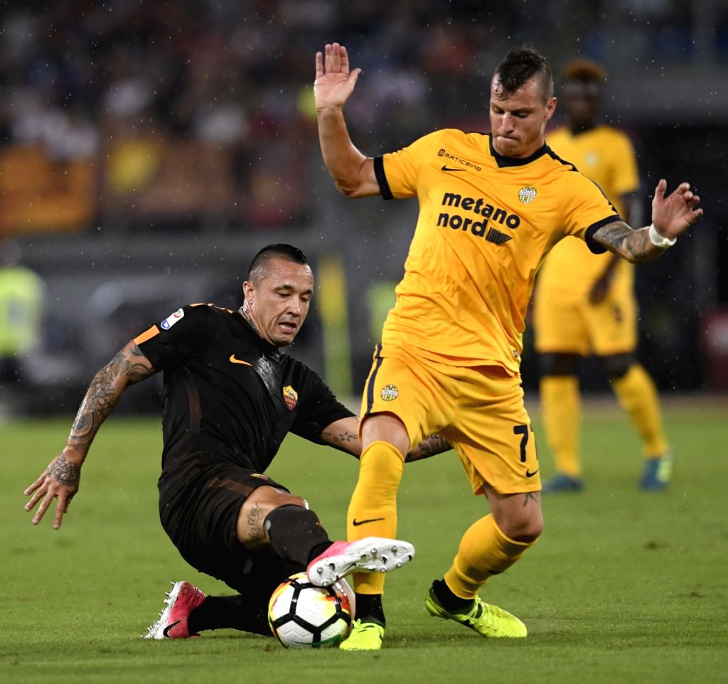 ROME, Sept. 17, 2017 - Roma's Radja Nainggolan (L) vies with Verona's Marcel Buchel during a Serie A soccer match between Roma and Verona in Rome, Italy, Sept. 16, 2017. Roma won 3-0.