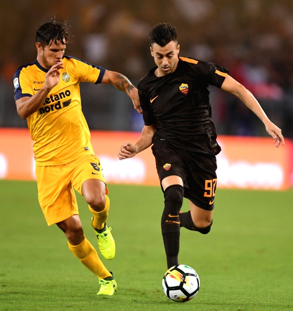 ROME, Sept. 17, 2017 - Roma's Stephan El Sharaawy (R) vies with Verona's Bruno Zuculini during a Serie A soccer match between Roma and Verona in Rome, Italy, Sept. 16, 2017. Roma won 3-0.