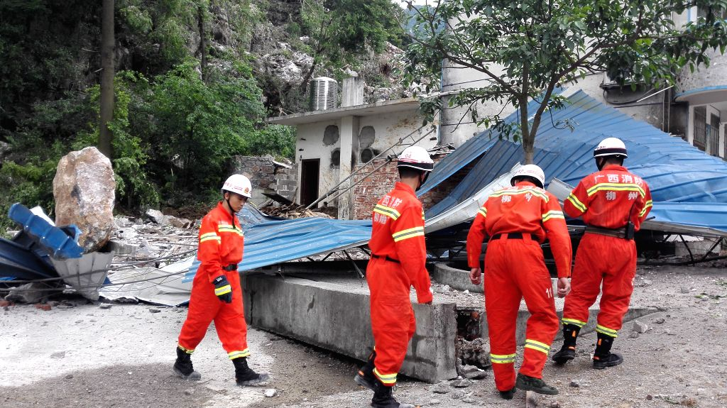 RONG'Rescuers check the landslide site at Liuliao Elementary School, Fushi Township of Rong'an County, south China's Guangxi Zhuang Autonomous Region, April 21, 2016. ...