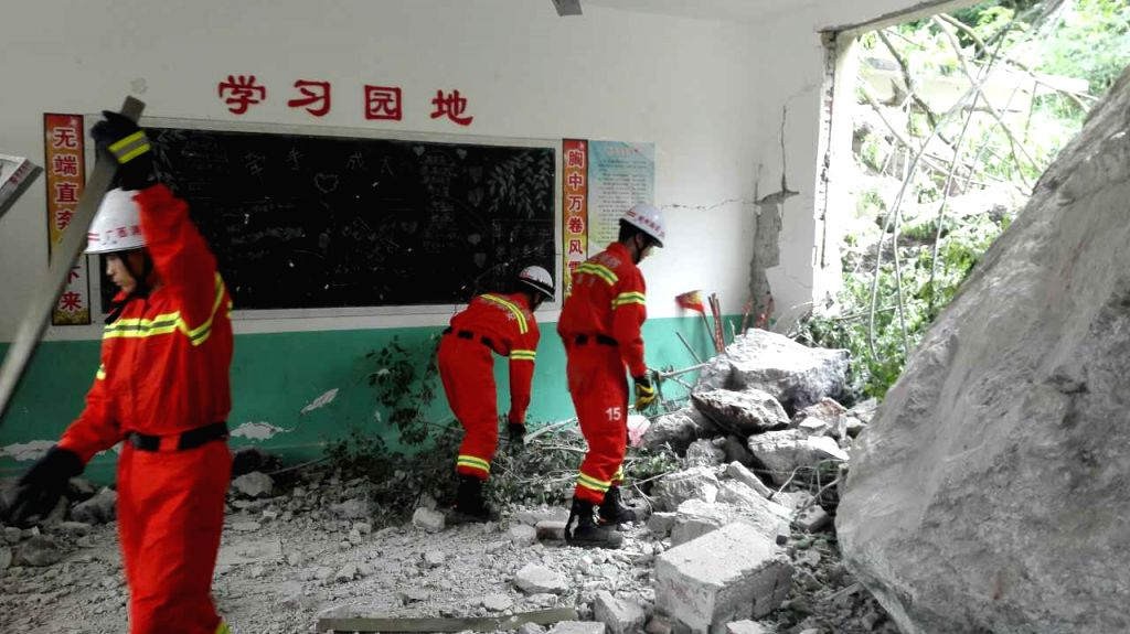 RONG'Rescuers work at the landslide site at Liuliao Elementary School in Fushi Township of Rong'an County, south China's Guangxi Zhuang Autonomous Region, April 21, ...