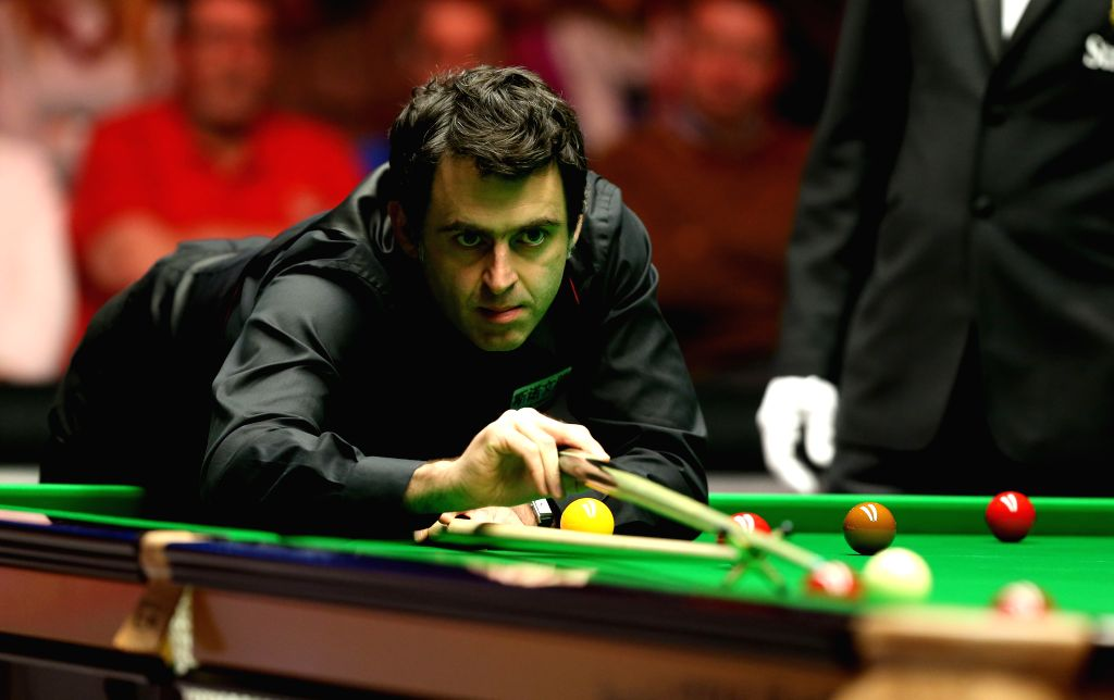 Ronnie O'Sullivan of England competes during the quarterfinal with Mark Selby of England at the Snooker Masters 2016 in London, Britain on Jan. 14, 2016. Ronnie ...
