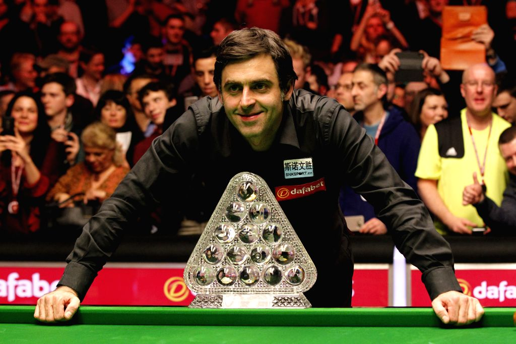 Ronnie O'Sullivan of England poses with his trophy after the final with Barry Hawkins of England at the Snooker Masters 2016 in London, England on Jan. 17, 2016. ...
