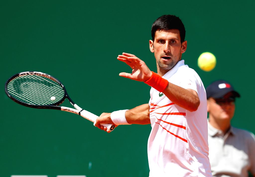 ROQUEBRUNE CAP MARTIN, April 20, 2019 (Xinhua) -- Novak Djokovic of Serbia hits a return during the men's singles quarterfinal match against Daniil Medvedev of Russia at the Monte-Carlo Rolex Masters tennis tournament in Roquebrune Cap Martin, France