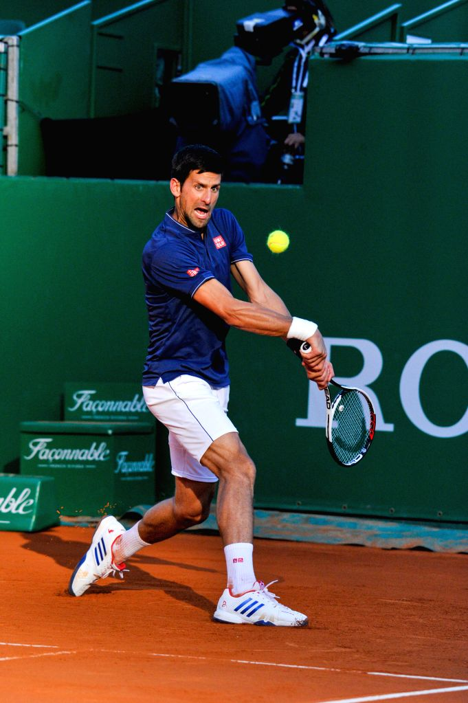 Roquebrune-Cap-Novak Djokovic of Serbia returns the ball during a round of 16 match Pablo Carreno Busta of Spain at the ATP World Tour Masters Monte Carlo in ...
