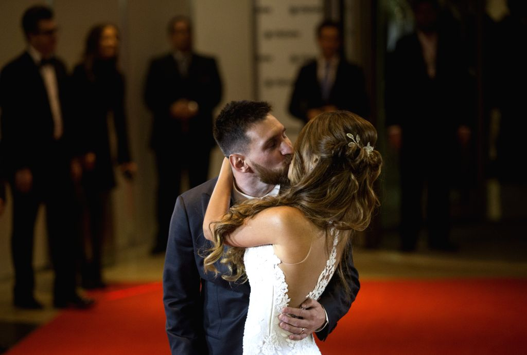ROSARIO, July 1, 2017 - Argentine soccer player Lionel Messi(L) kisses his wife Antonela Roccuzzo pose at their wedding in Rosario, Argentina, June 30, 2017.