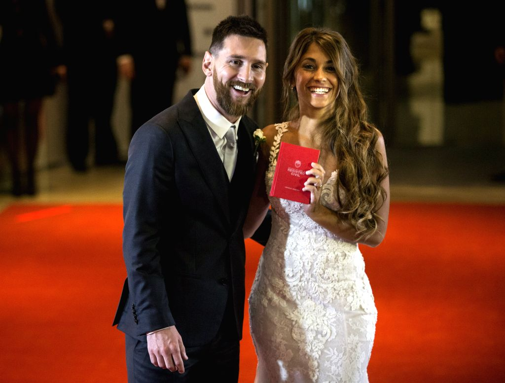 ROSARIO, July 1, 2017 - Argentine soccer player Lionel Messi(L) and his wife Antonela Roccuzzo pose at their wedding in Rosario, Argentina, June 30, 2017.