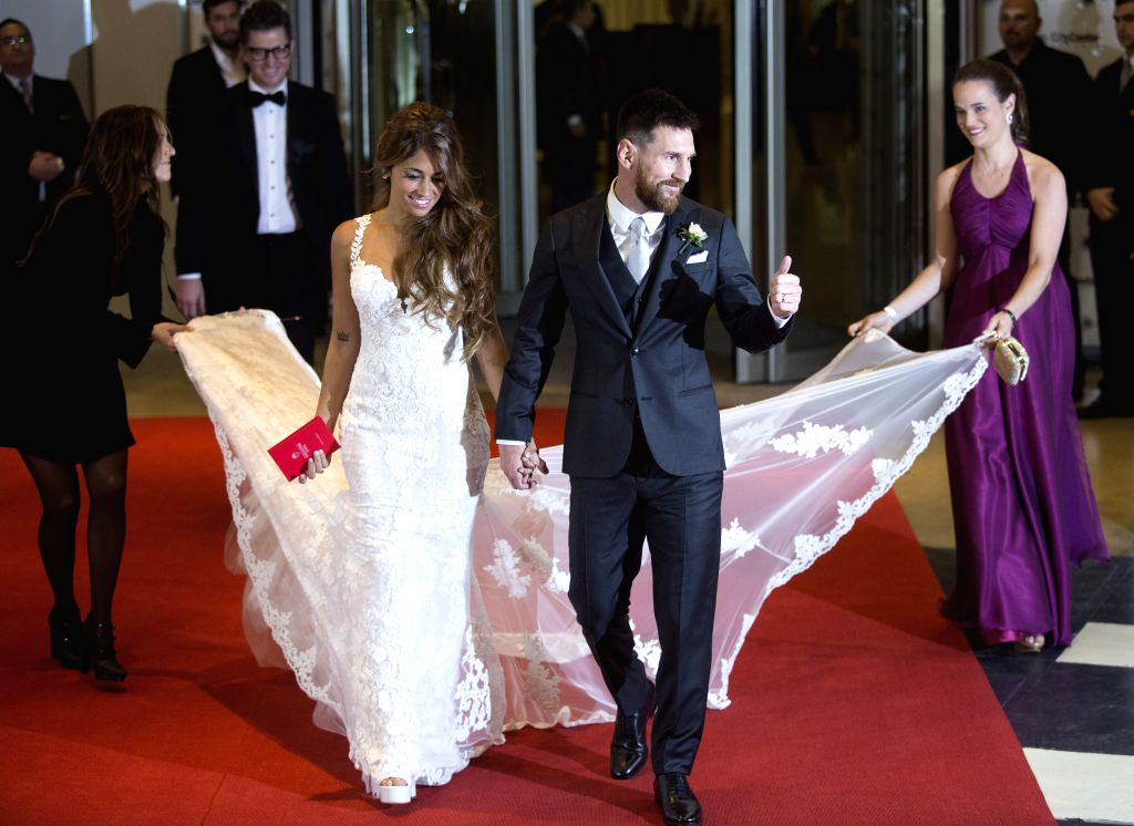 ROSARIO, July 1, 2017 - Argentine soccer player Lionel Messi(R) and his wife Antonela Roccuzzo make an appearance for the press at their wedding in Rosario, Argentina, June 30, 2017.