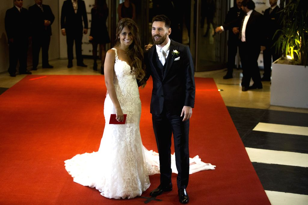 ROSARIO, July 1, 2017 - Argentine soccer player Lionel Messi(R) and his wife Antonela Roccuzzo pose at their wedding in Rosario, Argentina, June 30, 2017. /IANS)